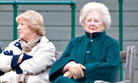 Margaret Thatcher with her carer, Kate, watching children playing football in Battersea Park.