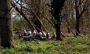 Older people having a picnic while on a walk