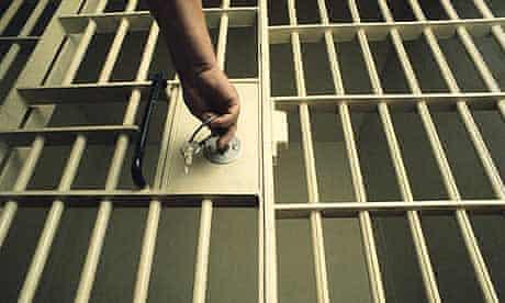 Locking a prison cell door.