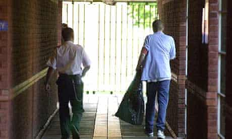 A prison officer accompanies a young offender at HMP Feltham B.