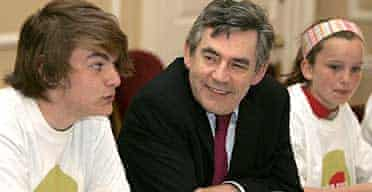 Prime minister Gordon Brown sits with Wilf Petheridge, youth mayor for Lewisham, and Eliza Gimson in a youth cabinet meeting in Downing Street.