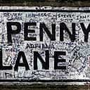 Fans' graffiti on the famous Penny Lane streetname in Liverpool.