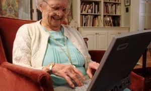 Elderly woman using a computer