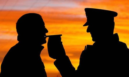 Man being breathalysed / alcohol / police / drink-driving