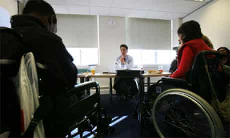 Ed Miliband meets learning disabilities service users Hedi (R) and Keith at Bedford House, Camden, north London