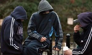 Teenagers wearing hoodies