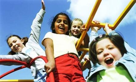 Four girls play on a climbing frame