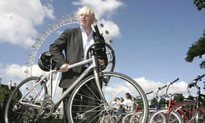 Wheels within wheels: Proud cyclist Boris Johnson in front of the London Eye
