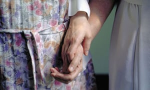 An older woman in a care home