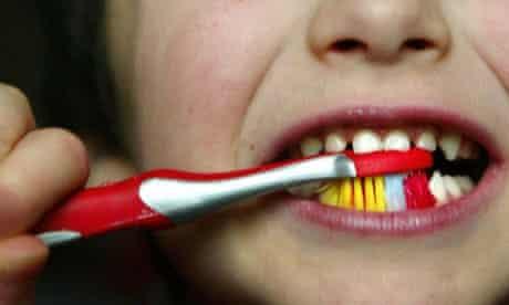 Child brushing teeth