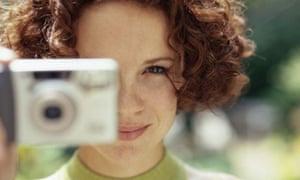 A woman uses a camera