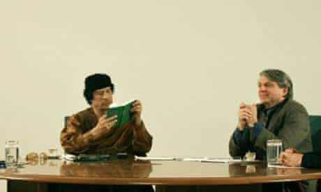 Libyan leader Muammar Gadhafi during a TV debate with American political theorist Benjamin Barber. Photograph: Nasser Nasser/AP