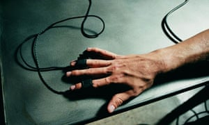 Lie detector close-up. Person's hand hooked up to polygraph test. Photograph: Seth Joel/Getty Images