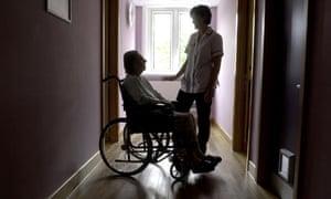 Wheelchair and nurse in a hospital