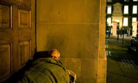 Homeless man in doorway
