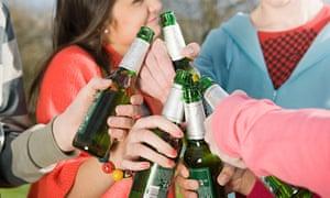 Teens with beer bottles
