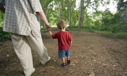 Grandmother walking with young boy
