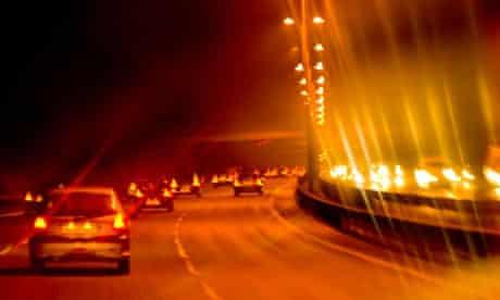 Traffic at night on a British motorway.