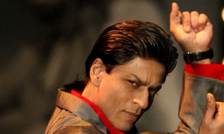 Bollywood star Shah Rukh Khan dances during a show to promote Om Shanti Om