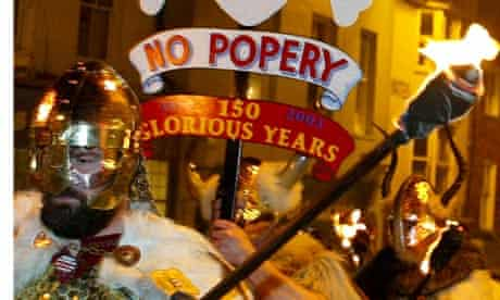 Local bonfire societies parade through Lewes in southern England for 'Guy Fawkes' night