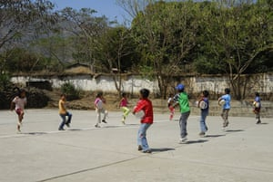 The Young Lives project: Children playing drums and dancing in Peru