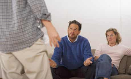 Parents discussing with son