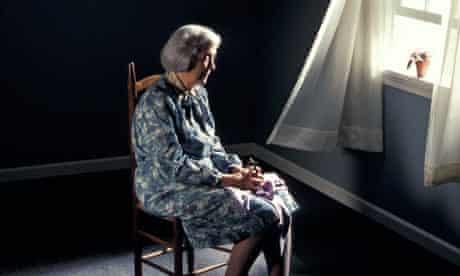 Elderly woman by window