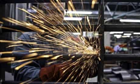A prisoner at Coldingley makes prison gates in the steel workshop