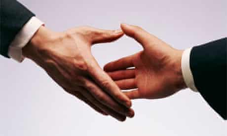 Business men in suits shaking hands