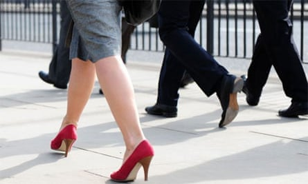 business woman in red shoes
