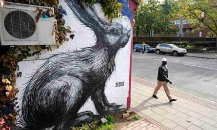 Rabbit, by Belgian graffitti artist ROA, outside The Premises music studios in Hackney