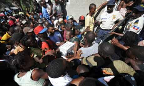 Aid is distributed to Haitian earthquake survivors