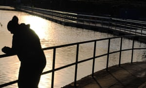 Lonely unemployed young woman by a canal towpath