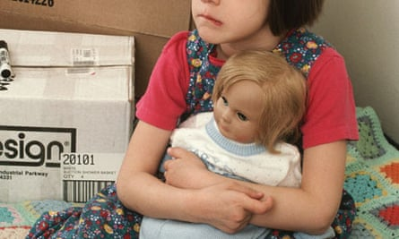 Young girl holding doll