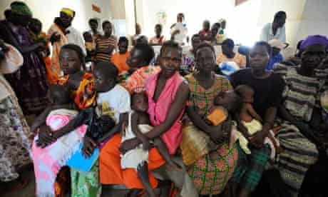 Women and children at a health centre in Katine, Uganda