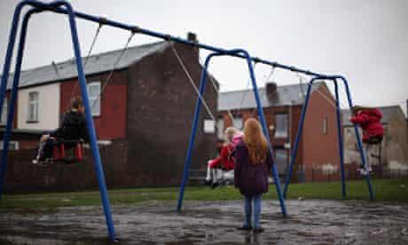 children on swings child poverty