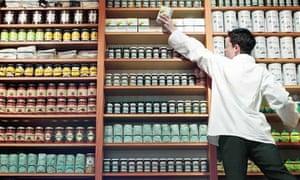 Teenage boy (15-17) stacking shelves in food store