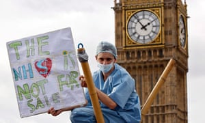 A demonstrator in front of Westminster during a protest against cuts to the NHS