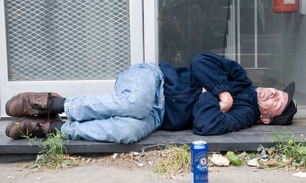 Homeless man asleep in Central London