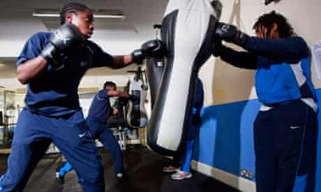 Boxing Academy pupils using punchbags