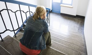 Depressed young woman in staircase