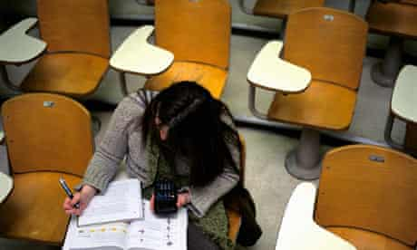 Girl sits alone in lecture hall