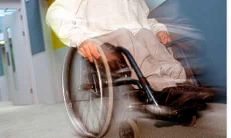 Disabled male in wheel chair in a residential home.