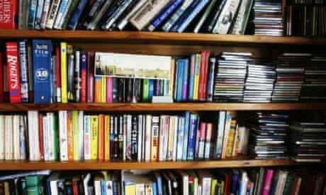 Bookshelves full of books, cds etc