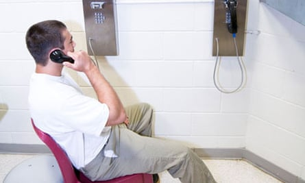 Prisoners in housing unit using the phone. Phone calls to and from prisoners are monitored by staff.
