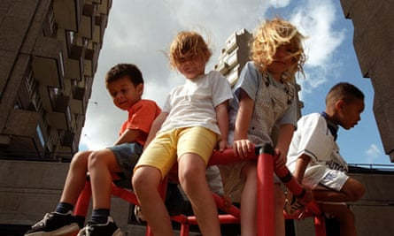 Children playing at open air nursery on housing estate in London.