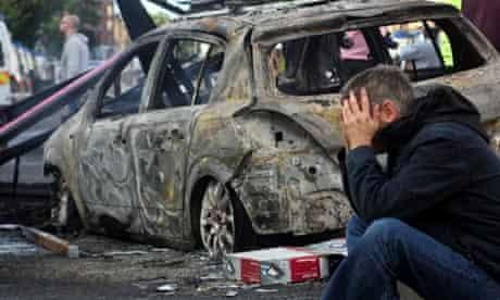 Burnt-out car after Tottenham riots