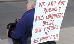 A protester demonstrates against cuts to benefits