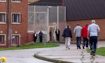 Prisoners walking outside between areas