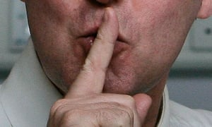 Man with finger on lips